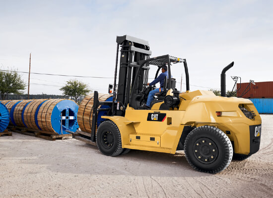 Operator Carrying Loads Outdoors with a Cat IC Pneumatic Tire Diesel Forklift