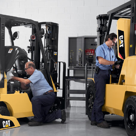 Technicians working on CAT Forklifts