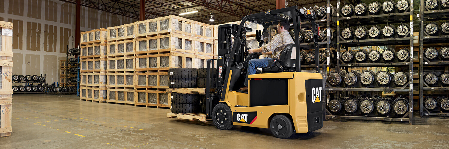 Cat forklift carrying cargo