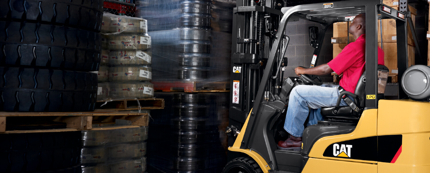 Man driving Cat IC cushion tire forklift
