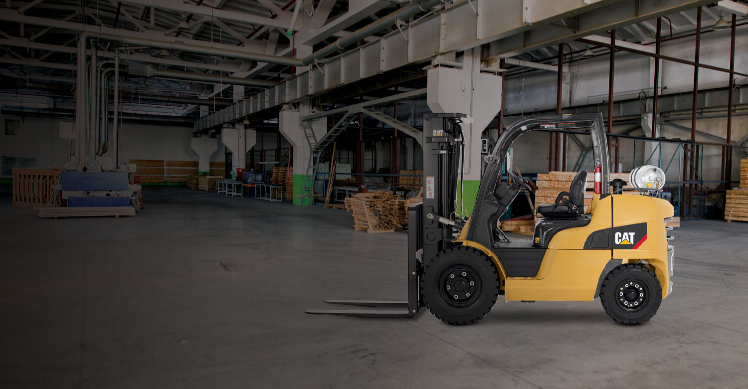 Cat IC Pneumatic tire forklift in dark warehouse