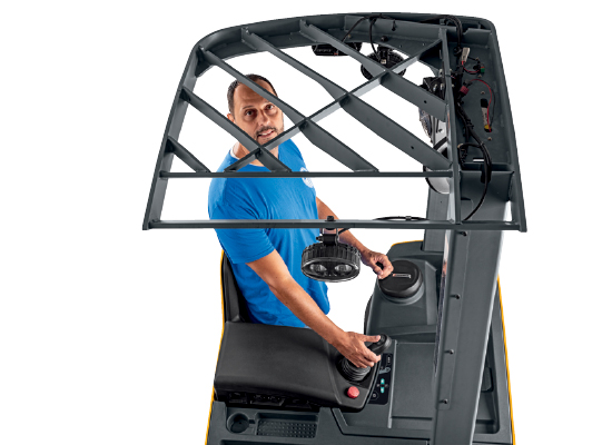 Operator Within a Stand-up Counterbalance Forklift Looking up Through the Overhead Guard