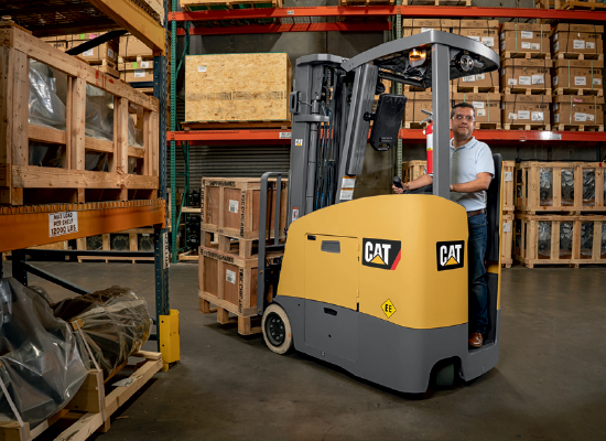 Operator Carrying Loads Through a Warehouse With a Cat Forklift