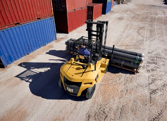 Cat DP70N forklift carrying steel tubes