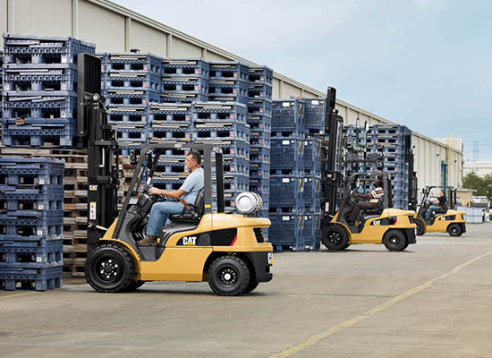 Cat GP15N fork trucks loading pallets outdoors