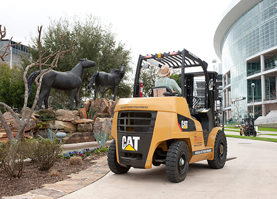 CAT Forklift next to a Horse Statue Garden at the Rodeo
