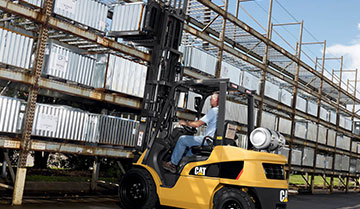 Operator Using a CAT IC Pneumatic Tire Lift Truck Outdoors