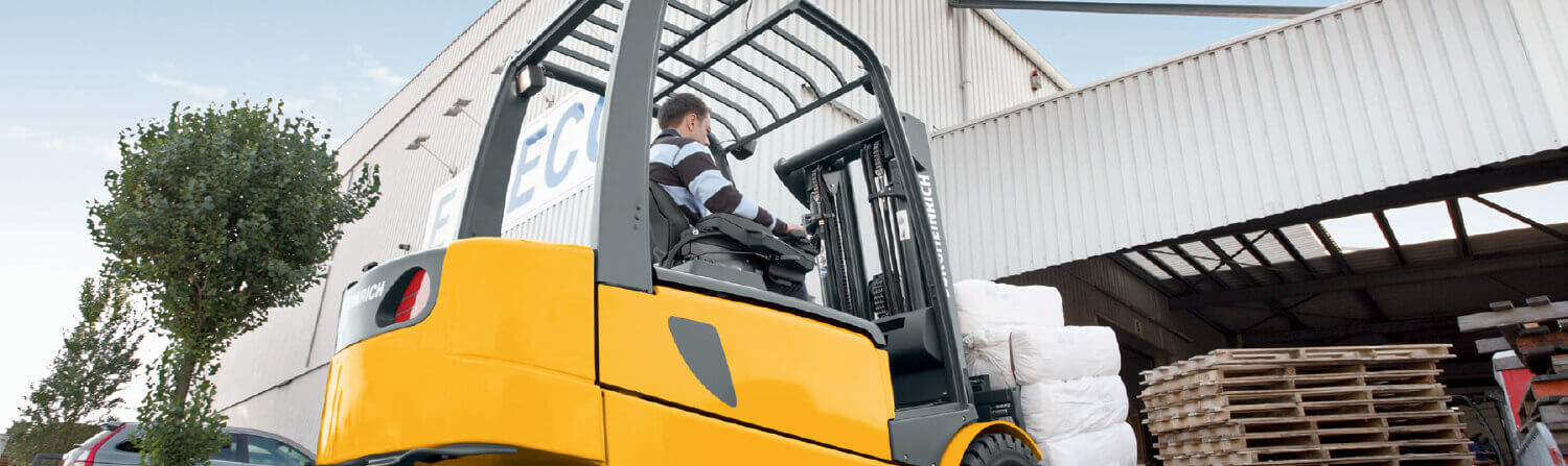 Jungheinrich forklift pulling into warehouse