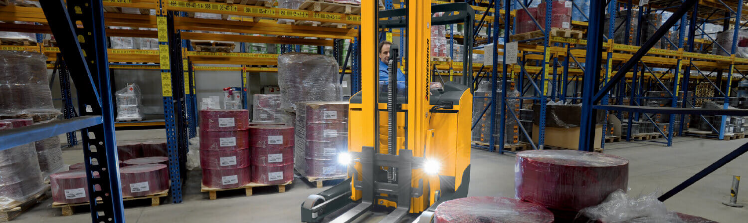 Lights on a Jungheinrich Forklift Shining While in Use in a Factory