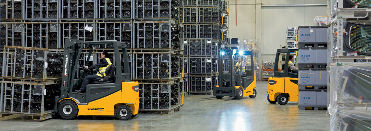 3 Jungheinrich forklifts driving around in warehouse