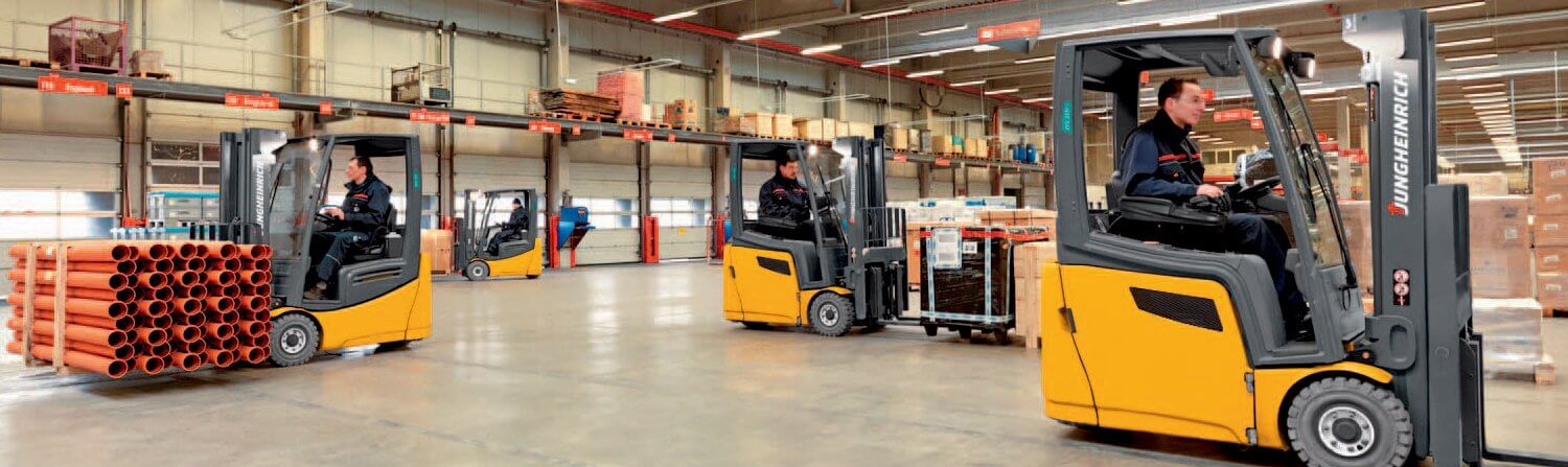 Jungheinrich forklifts working in warehouse