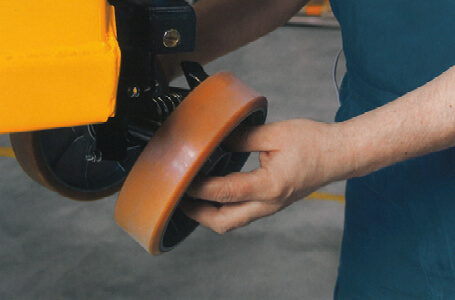 Technician Installing a Replacement Wheel onto a Jungheinrich Forklift