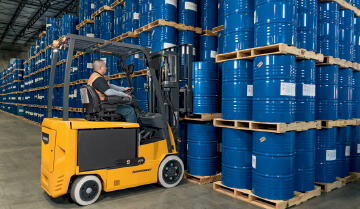 Operator Using a Jungheinrich Sit-Down Electric Counterbalanced Lift Truck in a Warehouse