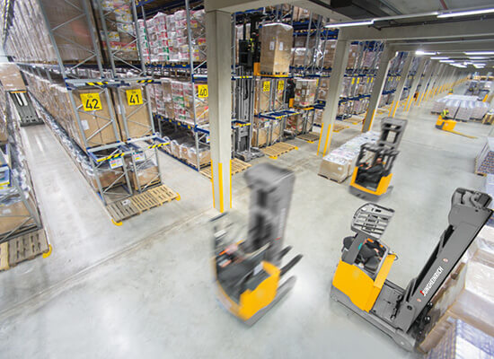 Jungheinrich Class 2 Moving Mast Reach Trucks Driving and Moving Materials in a Warehouse