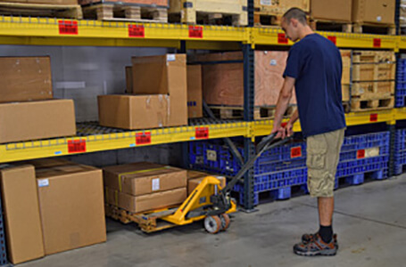 Worker Retrieving Merchandise with a Jungheinrich Hand Pallet Jack