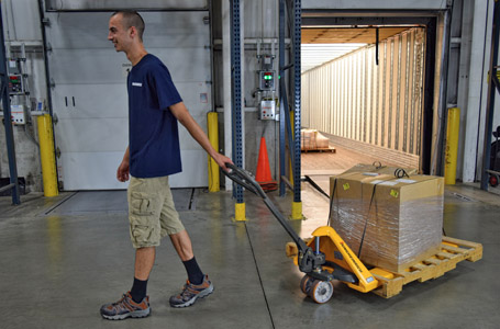 Worker Walking with Merchandise on a Jungheinrich Hand Pallet Jack