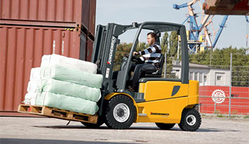 Operator Moving Materials Outdoors with a Jungheinrich EFG Forklift