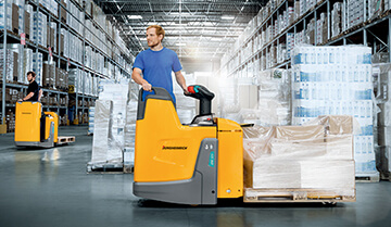 Man Operating a Loaded ERE 125/225 Powered pallet Truck