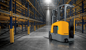 Jungheinrich lift truck in empty warehouse with shining light