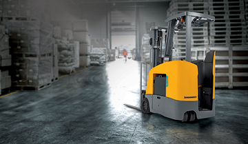 Jungheinrich stand-up counterbalanced lift truck in gray warehouse background