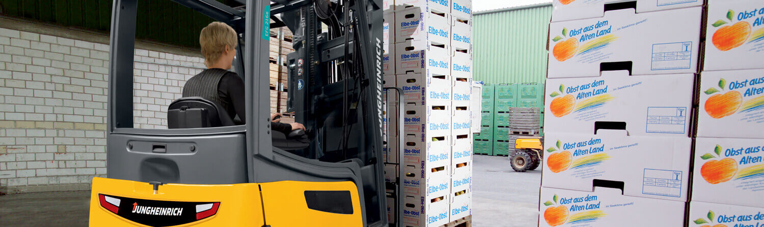 Jungheinrich forklift moving pallet of boxes