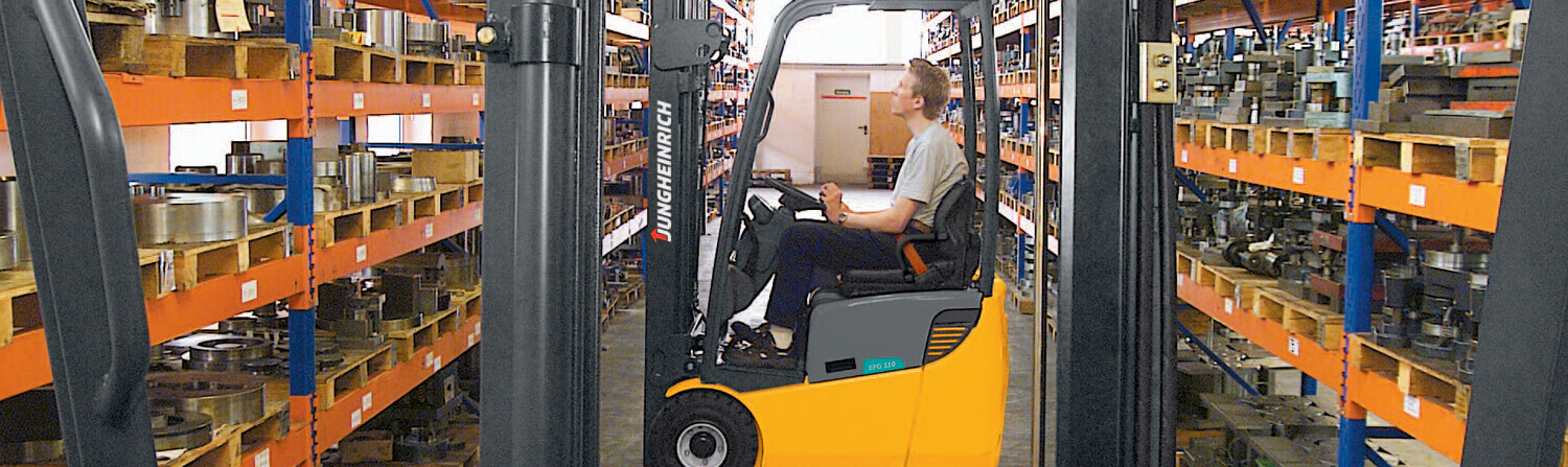 Side view of worker looking up while in Jungheinrich forklift