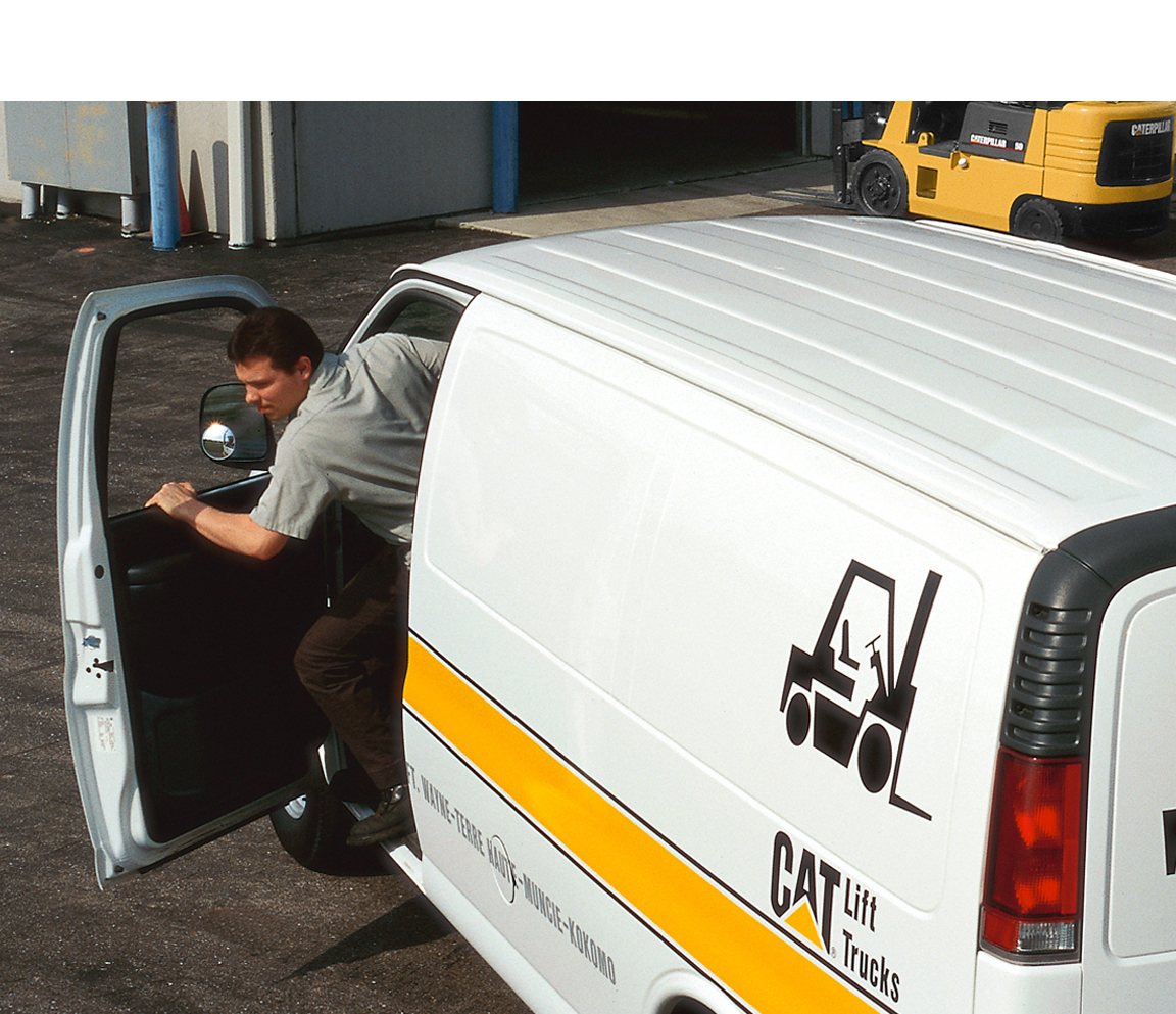 Man Exiting a Cat Branded SUV