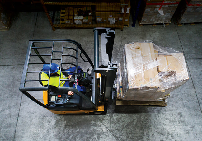 Forklift carrying load indoors