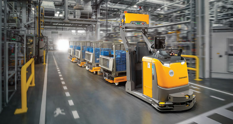 Automated Tow Tractor pulling carts in warehouse
