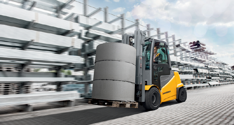 Jungheinrich Electric Forklift Hauling heavy cement cylinders