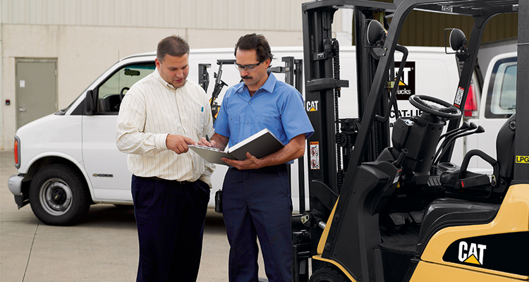 Man looking at contracts with forklift leasing agent