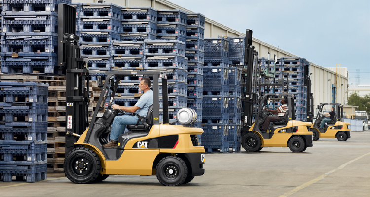 3 Cat IC lift trucks picking up pallets outside