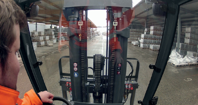 Man driving forklift in rain and snow