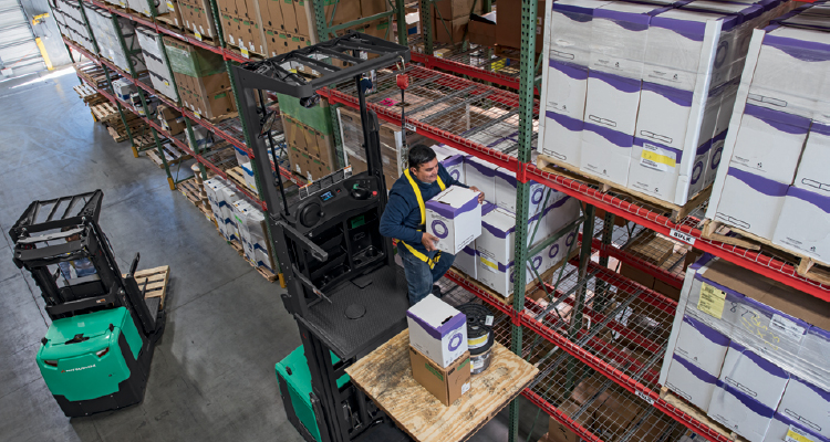 Mitsubishi forklift order pickers picking items from high racking