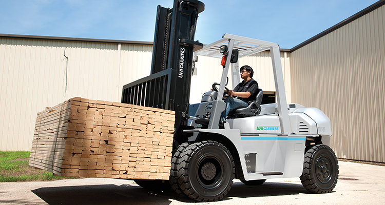 UniCarriers forklift carrying lumber