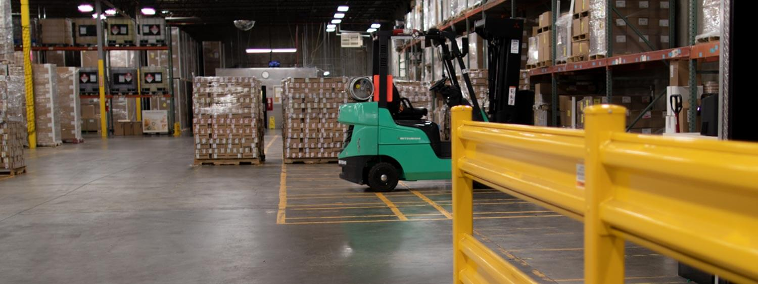 Mitsubishi Forklift Amidst Merchandise in a Warehouse