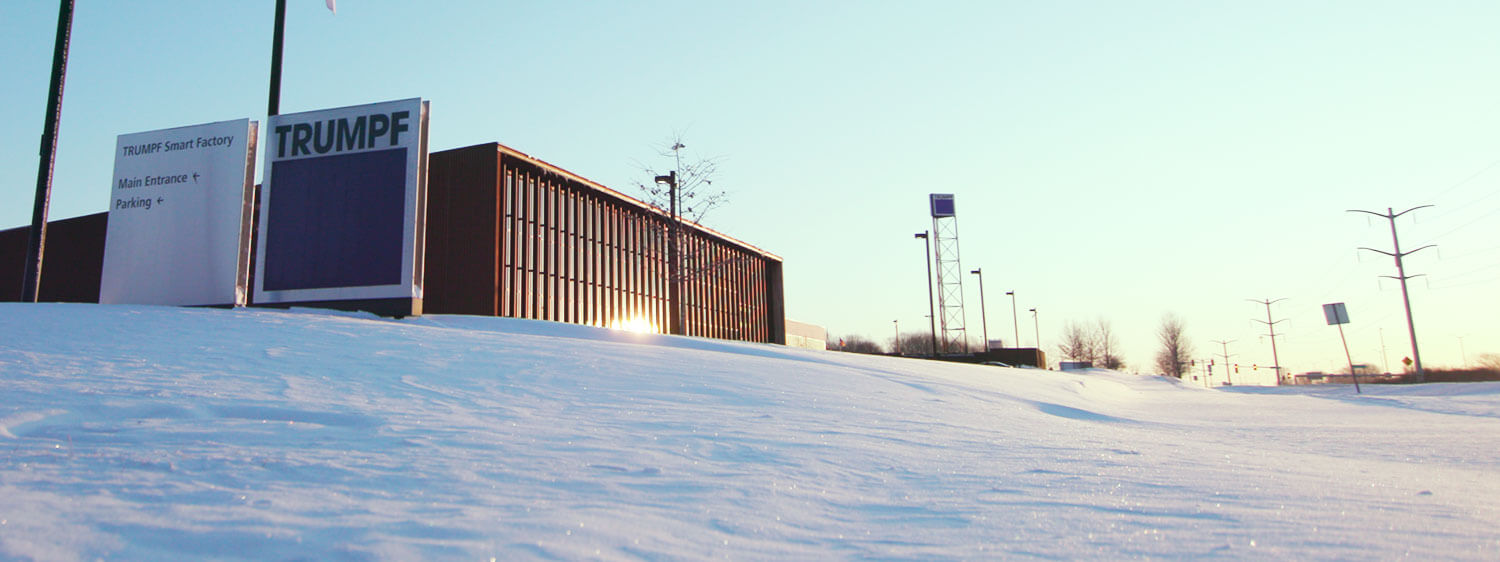 snow covered Trumpf smart factory building