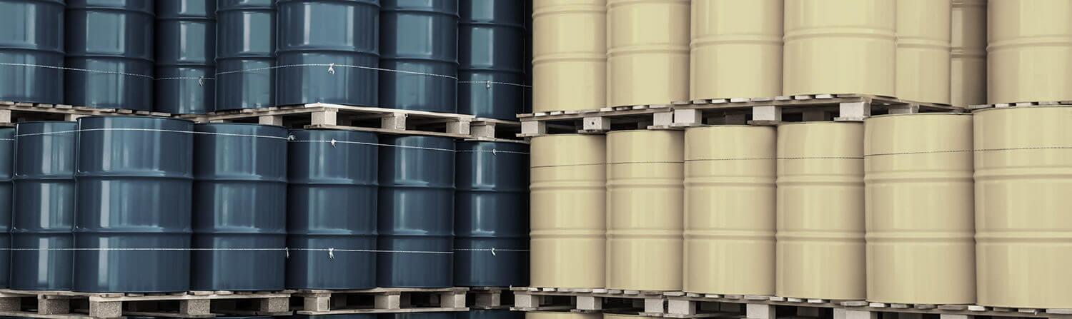 Blue and yellow barrels stacked next to each other