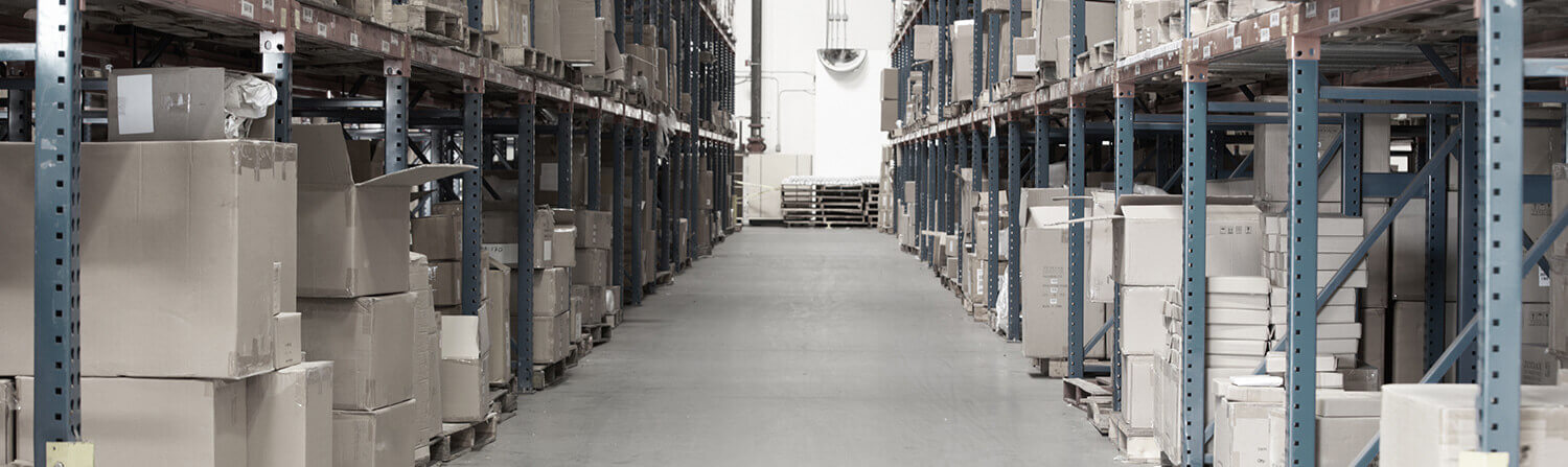 Background shot of gray-toned warehouse aisle with cardboard boxes