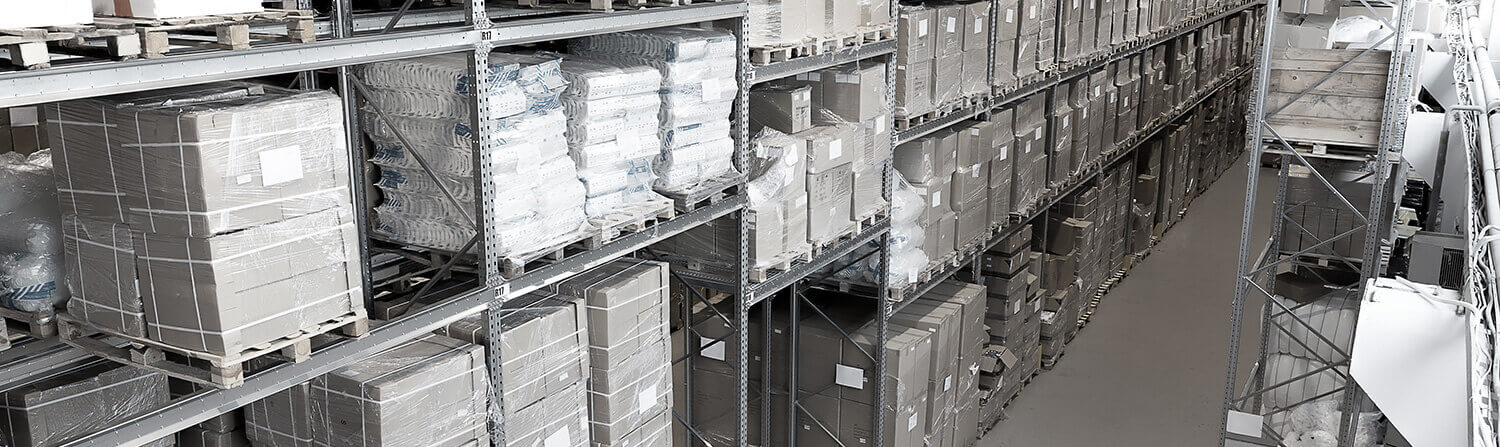 Background image of gray-toned warehouse aisle with bags