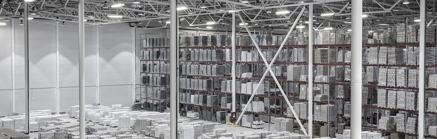 Gray toned warehouse background with shelves full of materials