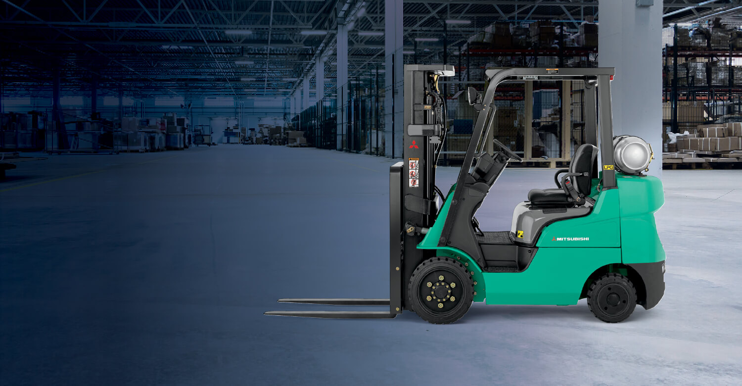 Mitsubishi IC cushion tire forklift in empty warehouse