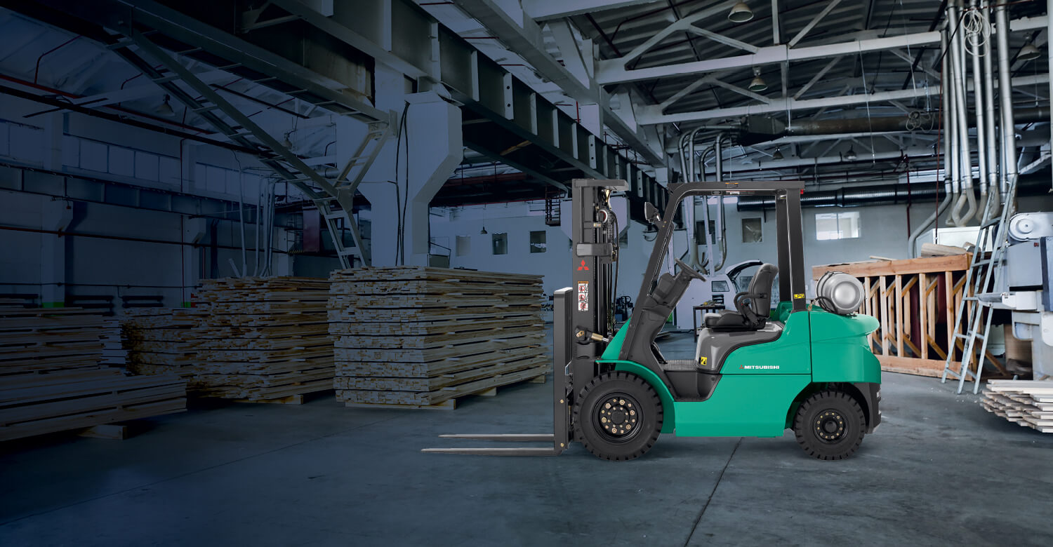 Mitsubishi IC pneumatic tire forklift in empty warehouse